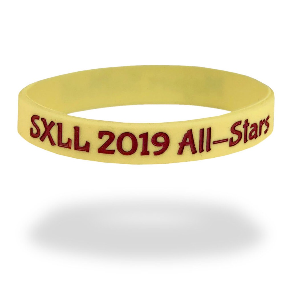 yellow event wristband with red text saying SXLL 2019 All-Stars